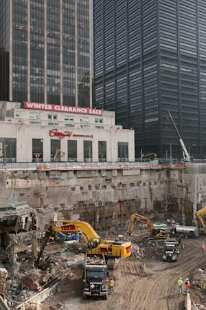 FILE - Construction workers and equipment excavate the southeastern corner of the World Trade Center site on in this Jan. 8, 2008 file photo taken in New York. About 60 truckloads of debris that could contain tiny human bone fragments have been unearthed by construction crews working on the new World Trade Center tower in recent years. That material is now being transported to a park built on top of the former Fresh Kills landfill on Staten Island. City officials say investigators will spend 10 weeks attempting to identify the remains. Investigators began sifting through newly uncovered debris from the World Trade Center on Monday April 1, 2013 for the first time in three years. (AP Photo/Mark Lennihan, File)