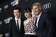 "Cast members Asa Butterfield (L), Hailee Steinfeld and Harrison Ford pose at the premiere of ""Ender's Game"" at the TCL Chinese theatre in Hollywood, California October 28, 2013. REUTERS/Mario Anzuoni"