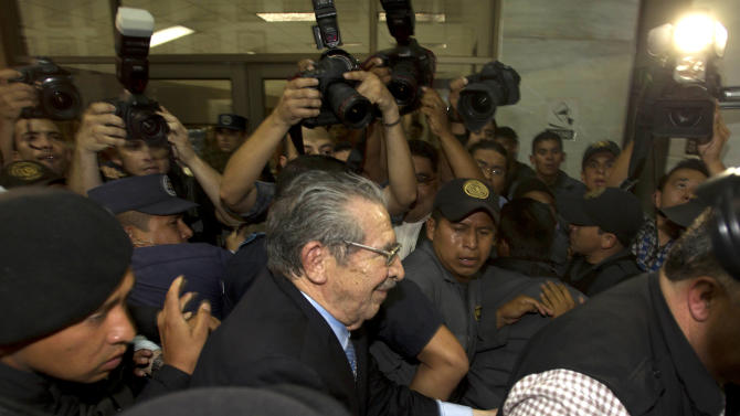 Guatemala's former dictator Efrain Rios Montt is escorted by police out of court after the verdict was announced in his genocide trial in Guatemala City, Friday, May 10, 2013. The Guatemalan court convicted Rios Montt on charges of genocide and crimes against humanity, sentencing him to 80 years in prison. The 86-year-old former general is the first former Latin American leader ever found guilty of such a charge. The war between the government and leftist rebels cost more than 200,000 lives and ended in peace accords in 1996. (AP Photo/Moises Castillo)