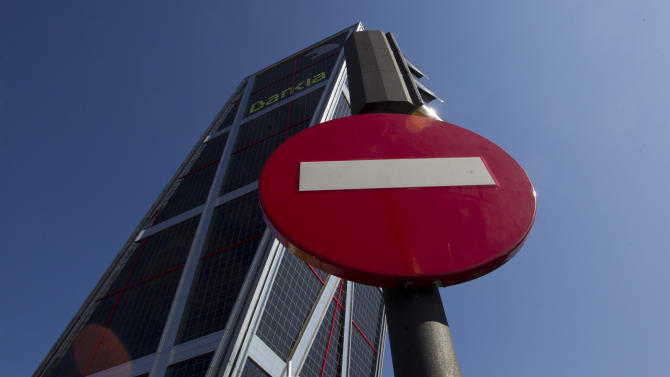 FILE - In this May 31, 2012 file photo, the Bankia bank headquarters in seen in Madrid. Shares of Spain's bailed-out bank Bankia plunged 13 percent on Thursday Dec. 27, 2012 after officials with the nation's bank bailout fund revealed the nationalized institution had a negative value of euro 4.2 billion ($5.6 billion). Bankia was formed in 2010 in a merger of seven unlisted Spanish savings banks whose heavy lending for property hurt them badly after the country's extended real estate boom collapsed in 2008. (AP Photo/Paul White, File)