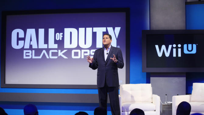 "Reggie Fils-Aime, president and chief operating officer of Nintendo of America, announces that ""Call of Duty Black Ops II"" will be available for the upcoming Wii U gaming console, Thursday, Sept. 13, 2012 in New York. The gaming console will start at $300 and go on sale in the U.S. on Nov. 18, in time for the holidays, the company said Thursday. (AP Photo/Mark Lennihan)"