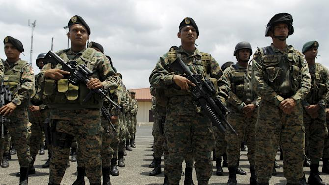 Members of the Panama National Police and Special forces Unit stand in formation as they take part in a security exercise at the Panama Pacific airport in Panama City