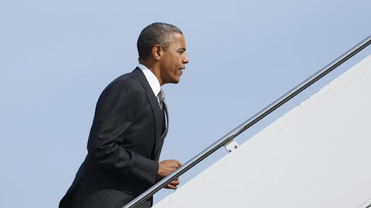 President Barack Obama boards Air Force One, Monday, Sept. 17, 2012, at Andrews Air Force Base, Md., en route to Ohio. (AP Photo/Carolyn Kaster)