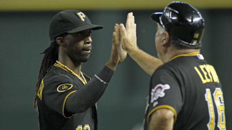Pittsburgh Pirates' Andrew McCutchen (22) is congratulated by third base coach Nick Levya following a 9-4 victory against the Arizona Diamondbacks during a baseball game, Friday, Aug. 1, 2014, in Phoenix. (AP Photo/ Ralph Freso)