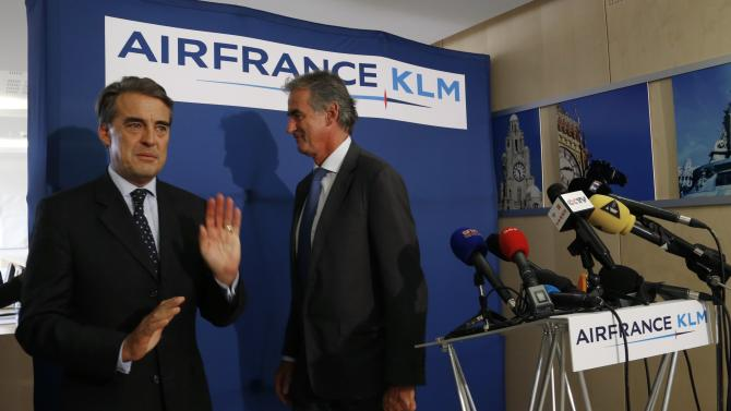 Chairman and CEO of Air France-KLM Alexandre de Juniac and Air France CEO Frederic Gagey leave after a news conference in Paris on the second week of a strike by Air France pilots