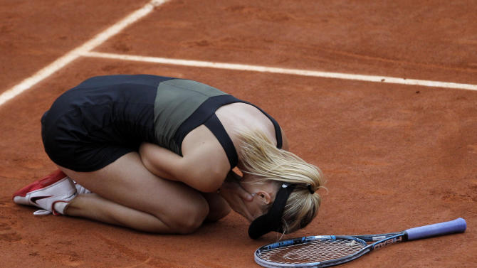 Russia's Maria Sharapova reacts as she defeats Italy's Sara Errani in their women's final match in the French Open tennis tournament at the Roland Garros stadium in Paris, Saturday, June 9, 2012. Sharapova won 6-3, 6-2.  (AP Photo/Michel Spingler)