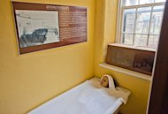 In this Friday, Dec. 16, 2011 photo, a display describing how hydrotherapy treatment was used on patients is shown at the Trans-Allegheny Lunatic Asylum in Weston, W. Va. The former psychiatric hospital is now being marketed as a historic and paranormal tourist attraction. (AP Photo/David Smith)