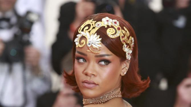 """Barbadian singer, actress and fashion designer Rihanna arrives for the Metropolitan Museum of Art Costume Institute Gala 2015 celebrating the opening of """"China: Through the Looking Glass,"""" in Manhattan"""
