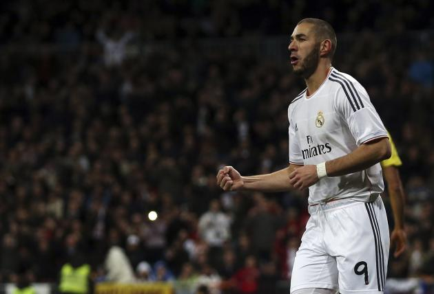 Real Madrid's Benzema celebrates after scoring a goal against Villarreal during their Spanish first division soccer match in Madrid
