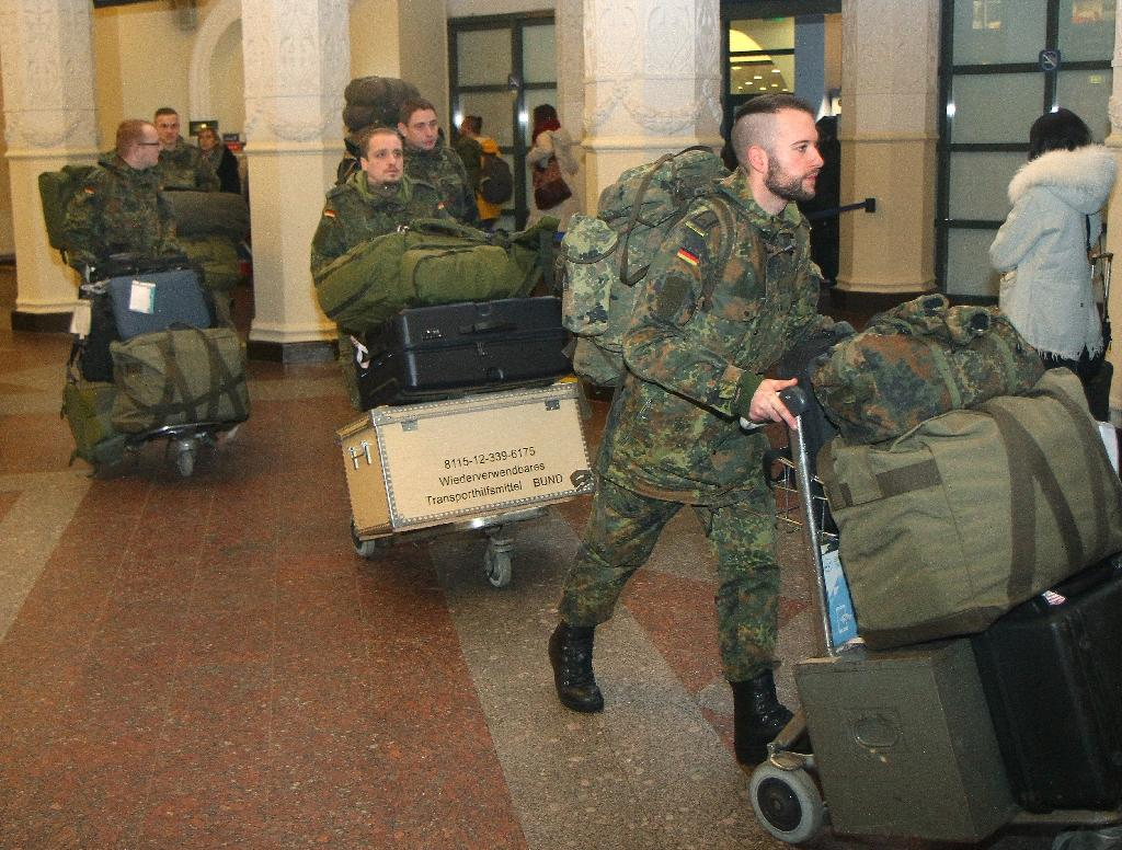 Germans, Belgians land in Lithuania for NATO deployment