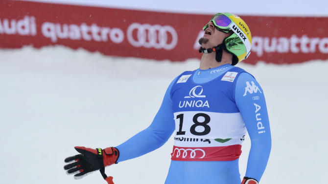 Italy's Dominik Paris reacts after his run of the men's downhill  at the Alpine skiing world championships in Schladming, Austria, Saturday, Feb. 9, 2013. (AP Photo/Kerstin Joensson)