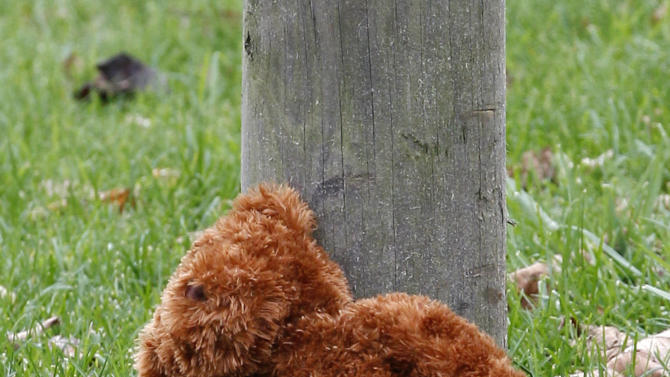 A teddy bear rests at the post of a sign near the entrance to the parking lots for the Pittsburgh Zoo and PPG Aquarium on Monday, Nov. 5, 2012, in Pittsburgh. Zoo officials said a young boy was killed after he fell into the exhibit that was home to a pack of African painted dogs who pounced on the boy and mauled him on Sunday, Nov. 4, 2012. (AP Photo/Keith Srakocic)