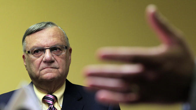 FILE - In this April 3, 2012 file photo, Maricopa County Sheriff Joe Arpaio listens to one of his attorneys during a news conference in Phoenix. Arpaio is expected to take the witness stand Tuesday, July 24, 2012, and face allegations that his trademark immigration sweeps amounted to racial profiling against Hispanics. (AP Photo/Ross D. Franklin, File)
