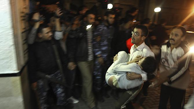 A Palestinian relative carries a wounded girl into the treatment room of Shifa hospital following an Israeli airstrike, in Gaza City, Wednesday, Nov. 14, 2012. The Israeli military said its assassination of the Hamas military commander Ahmed Jabari, marks the beginning of an operation against Gaza militants. (AP Photo/Majed Hamdan)