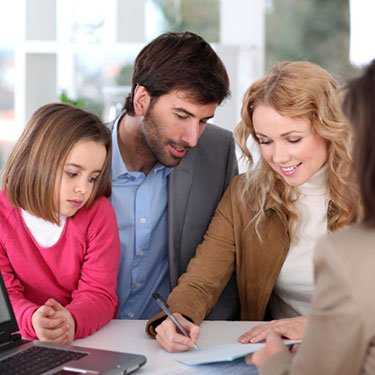 Couple-with-young-girl-buying-house_web