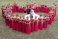 Bride Katie Dalby with all 80 bridesmaids.