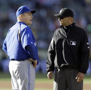 Toronto Blue Jays manager John Gibbons, left, speaks with first base umpire Vic Carapazza in the second inning of a baseball game against the Oakland Athletics, Thursday, July 3, 2014, in Oakland, Calif. (AP Photo/Ben Margot)