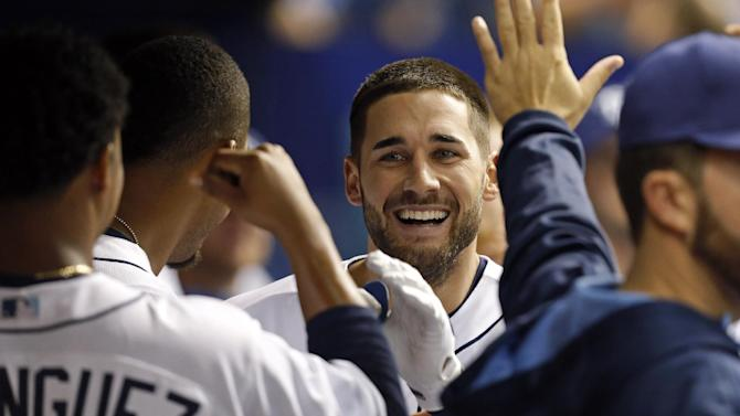Tampa Bay Rays' Kevin Kiermaier is congratulated teammates after he rounded all the bases to score after reaching on a fielding error by Toronto Blue Jays left fielder Steve Tolleson during the fifth inning of a baseball game Friday, April 24, 2015, in St. Petersburg, Fla. (AP Photo/Mike Carlson)