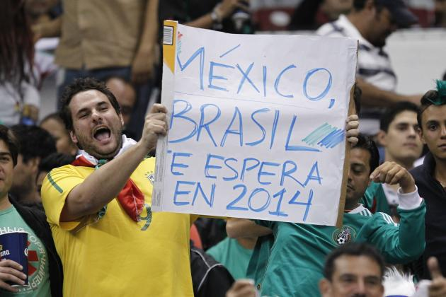 "A Mexico fan holds a poster that reads ""Mexico, Brazil awaits in 2014"" during their 2014 World Cup qualifying soccer match against Panama in Mexico City"