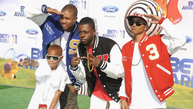 "FILE - In a June 26, 2011 file photo the band Cali Swag District arrives at the BET Awards in Los Angeles. The group's debut album, ""The Kickback,"" is being released by Capitol Records on July 12, 2011. (AP Photo/Chris Pizzello)"