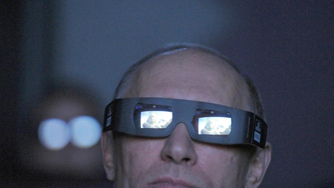 Russian Prime Minister Vladimir Putin wears 3D glasses as he visits Moscow's Planetarium in Moscow, Thursday, April 12, 2012. Putin chaired a meeting with officials on building a new space launchpad in Russia's far east that should become operational by 2018. (AP Photo/RIA-Novosti, Alexei Druzhinin, Government Press Service)