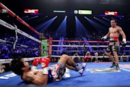 Manny Pacquiao falls to the canvas after being knocked down by Juan Manuel Marquez on December 8, 2012 in Las Vegas. Marquez caught him with a huge right hand that saw the Filipino crumple to the canvas -- his second successive defeat