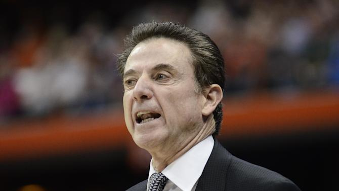 Louisville coach Rick Pitino calls out to his team during the first half of a regional semifinal against North Carolina State in the NCAA men's college basketball tournament Friday, March 27, 2015, in Syracuse, N.Y.  (AP Photo/Heather Ainsworth)