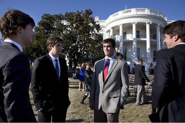 Alex Scheinman, second from left, next to Harrison Richmond, and teammates from the University of Virginia Men's Tennis team talk on the South Lawn of the White House after President Barack Obama