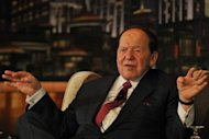 Chairman and CEO of Las Vegas Sands Corporation Sheldon Adelson gestures at a press conference before the opening of the Sands Cotai Central, Sands&#39; newest integrated resort in Macau before its opening, April 2012. US gaming tycoon Sheldon Adelson&#39;s Macau-based subsidiary Sands China said it is under investigation over the transfer of data from the Chinese territory to the United States