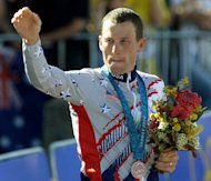 Lance Armstrong celebrates after winning the bronze medal in the men&#39;s time trial of the Sydney Olympic Games on September 30, 2000. The International Olympic Committee (IOC) has asked Armstrong to return the Olympic bronze medal he won at the 2000 Games in Sydney
