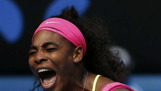Williams of the U.S. reacts after winning a point against compatriot Keys of the U.S. during their women's singles semi-final match at the Australian Open 2015 tennis tournament in Melbourne