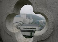 A view of a nuclear power plant as seen through designs from a hilltop structure in 2005 in China. Energy-hungry China could restart its nuclear projects, suspended after Japan&#39;s Fukushima disaster in March last year, while new safety standards have been adopted in active plants, the government said