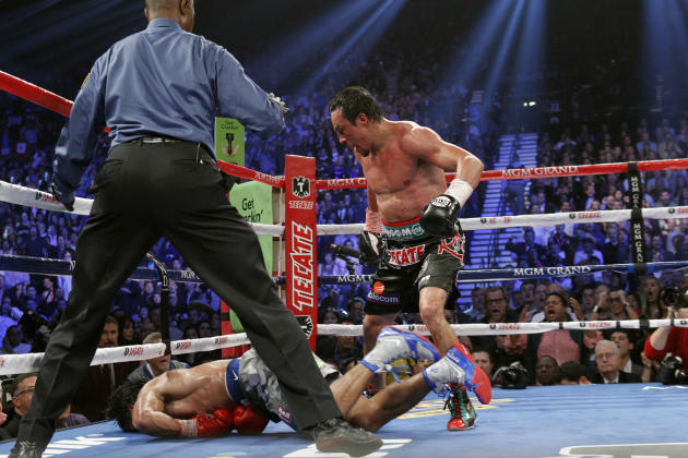 Juan Manuel Marquez of Mexico steps away after knocking out Manny Pacquiao of the Philippines in the 6th round during their welterweight fight at the MGM Grand Garden Arena in Las Vegas