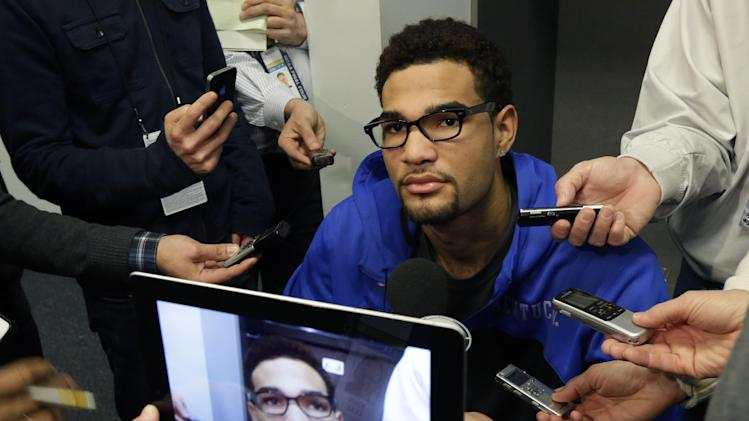 Kentucky forward Willie Cauley-Stein is interviewed in the locker room before practice for the NCAA Final Four tournament college basketball championship game Sunday, April 6, 2014, in Arlington, Texas. Kentucky plays Connecticut in the championship game on Monday, April 7. 2014