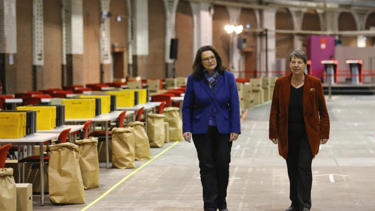 "SPD Secretary General Nahles and fellow party member Hendricks walk in the hall where later today volunteers of the SPD will count the votes of the ""Member Vote"" for a new ""grand coalition"" between the SPD and the CDU in Berlin"
