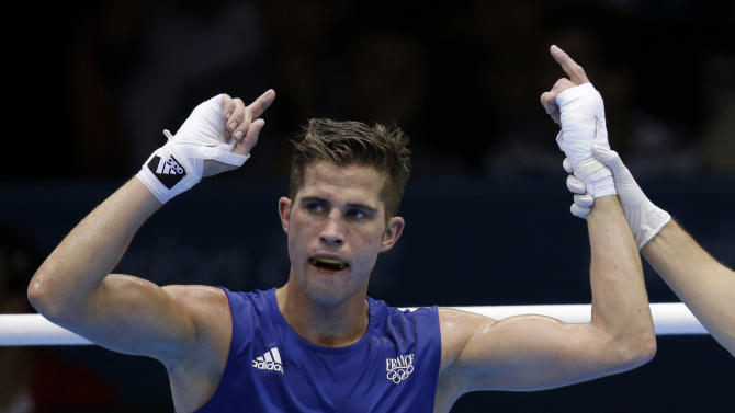 FILE.-  In this Aug. 3, 2012 file photo, France's Alexis Vastine reacts after defeating Mongolia's Tuvshinbat Byamba in a men's welterweight 69-kg preliminary boxing match at the 2012 Summer Olympics, in London.  Two helicopters carrying French sports stars filming a popular European reality show crashed in a remote part of Argentina, killing 10 people, including French Olympic gold medal swimmer Camille Muffat, Olympic boxer Alexis Vastine and sailor Florence Arthaud, according to a statement from La Rioja's government. (AP Photo/Patrick Semansky/File)
