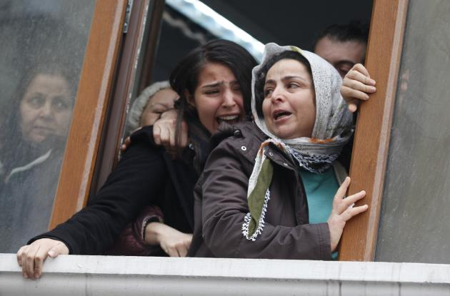 Elvan's sister reacts as his coffin approaches the Okmeydani cemevi, an Alevi place of worship, in Istanbul