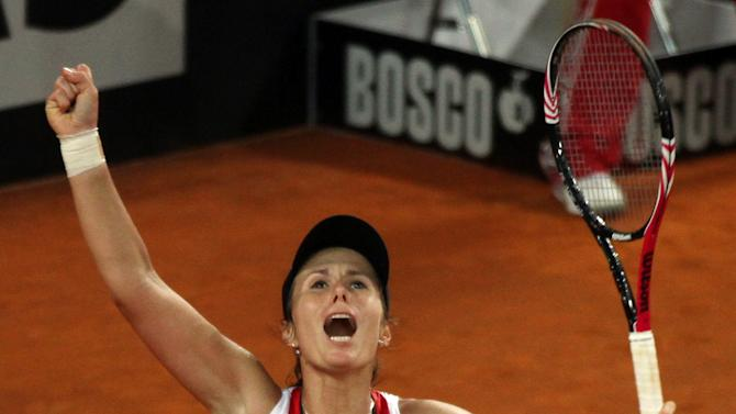 United States' Varvara Lepchenko celebrates after defeating Italy's Roberta Vinci during a World Group first round Fed Cup tennis match at the 105 stadium in Rimini, Saturday, Feb. 9, 2013. Lepchenko won 2-6, 6-4, 7-5. (AP Photo/Felice Calabro')