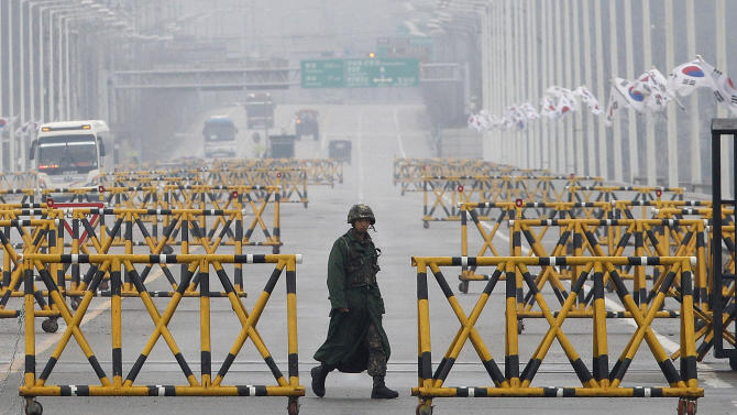 A South Korean Army soldier walks on Unification Bridge in Paju, South Korea, near the border village of Panmunjom, Saturday, April 6, 2013. More South Koreans on Saturday began to leave North Korea and the factory park where they work, four days after Pyongyang closed the border to people and goods. (AP Photo/AhnnYoung-joon)