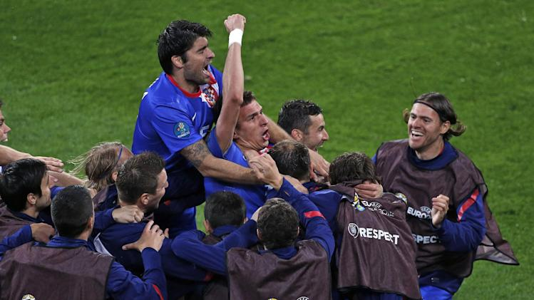 Croatia's Mario Mandzukic, center, celebrates after he scored his team's third goal during the Euro 2012 soccer championship Group C match between the Republic of Ireland and Croatia in Poznan, Poland, Sunday, June 10, 2012. (AP Photo/Anja Niedringhaus)