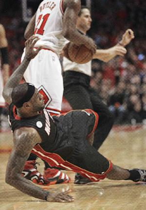 Miami Heat small forward LeBron James (6) falls to the floor after being pushed by Chicago Bulls center Nazr Mohammed during the first half of Game 3 of an NBA basketball playoffs Eastern Conference semifinal on Friday, May 10, 2013, in Chicago. Mohammed was ejected after this play.  (AP Photo/Charles Rex Arbogast)