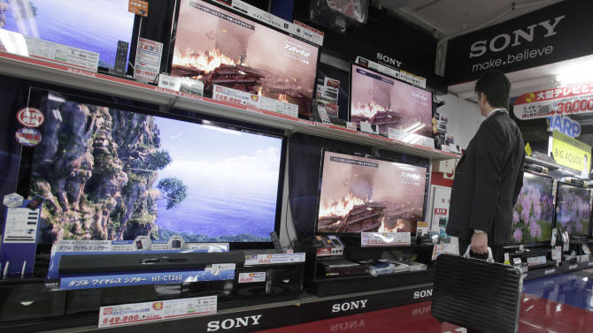 A man looks at Sony's Bravia flat panel TV sets on display at a Tokyo electronics store Thursday, Nov. 1, 2012. Sony Corp. reported Thursday a smaller flow of red ink for the fiscal second quarter on a sales recovery and restructuring efforts and stuck to its full year forecast for a return to profit from its worst loss in company history the previous year. The Japanese electronics and entertainment company recorded a 15.5 billion yen ($193 million yen) loss for the July-September period, much better than the 27 billion yen loss racked up the same period the previous year. (AP Photo/Shizuo Kambayashi)