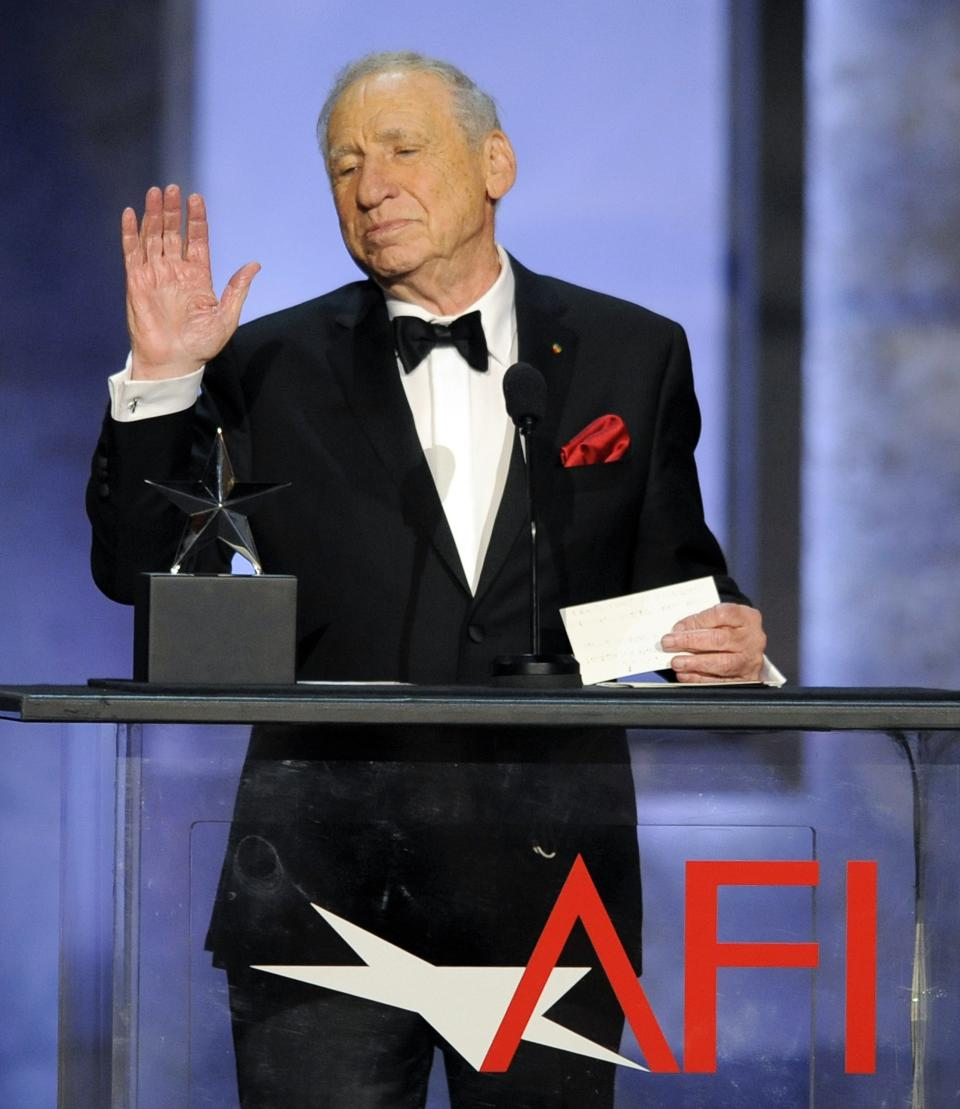 Honoree Mel Brooks waves to the audience after receiving his award at the American Film Institute's 41st Lifetime Achievement Award Gala at the Dolby Theatre on Thursday, June 6, 2013 in Los Angeles. (Photo by Chris Pizello/Invision/AP)