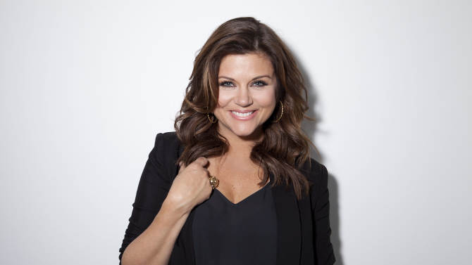 """This Feb. 6, 2013 file photo shows actress Tiffani Thiessen posing for a portrait in New York. Thiessen, best known for her former role as Kelly Kapowski on TV's """"Saved by the Bell,"""" says she had no idea at the time of how popular the show was. She says she's grateful she grew up in the limelight before TMZ and other 24 hour media outlets and gossip blogs came along. She currently stars in the USA series """"White Collar."""" (Photo by Amy Sussman/Invision/AP)"""