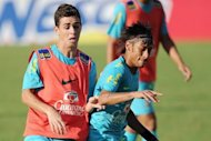 Brazilian footballers Oscar (left) and Neymar take part in a training session of the national team participating in the London Olympics, in Rio de Janeiro on July 11. Midfielder Oscar has said that he will make up his mind about whether to sign for Premier League giants Chelsea after the Olympics
