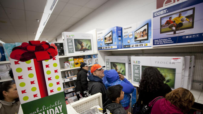 IMAGE DISTRIBUTED FOR KMART - Customers shop for televisions in the Kmart electronics department as they look for doorbuster deals at the Addison Street store in Chicago on Thanksgiving Thursday, Nov. 22, 2012. Kmart was the first major retailer nationwide to kick off pre-Black Friday shopping on Thanksgiving morning at 6 a.m.  (John Konstantaras/AP Images for Kmart)