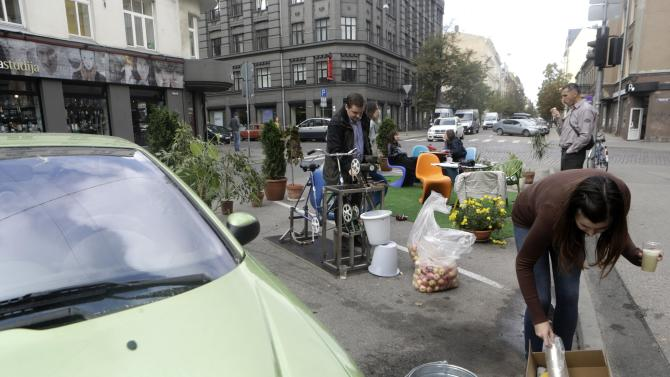 People attend a PARK(ing) Day event in Riga