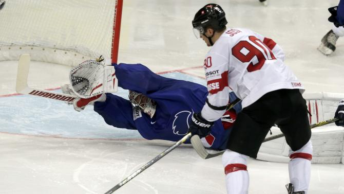 Switzerland's Josi shoots to score a goal past France's goaltender Huet during their Ice Hockey World Championship game at the O2 arena in Prague