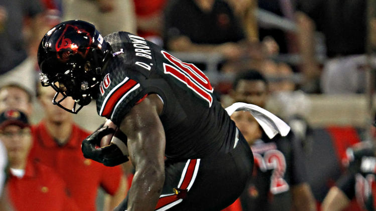 Louisville defeats Miami 31-13 in ACC debut