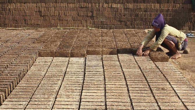 A worker makes bricks at Boja village in Kendal